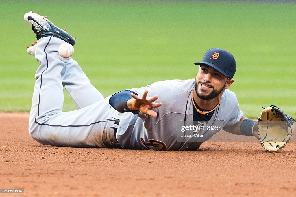 Shortstop Mike Aviles #14 of the Detroit Tigers tries to make the play on a ground ball hit by Mike Napoli #26 of the Cleveland Indians during the fifth inning at Progressive Field on May 5, 2016 in Cleveland, Ohio.