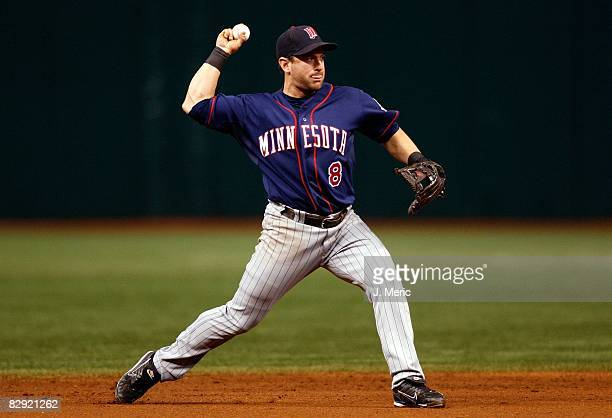 Shortstop Nick Punto of the Minnesota Twins throws over to first against the Tampa Bay Rays during the game on September 18 2008 at Tropicana Field...