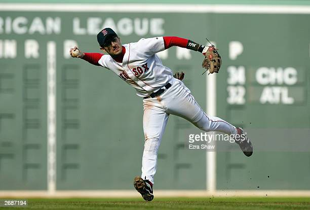 Shortstop Nomar Garciaparra of the Boston Red Sox throws the ball during game four of the American League Division Series against the Oakland...