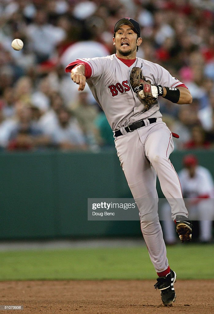 Shortstop Nomar Garciaparra #5 of the Boston Red Sox throws to first to record the force out on David Eckstein #22 of the Anaheim Angels on July 15, 2004 at the Angel Stadium of Anaheim in Anaheim, California.