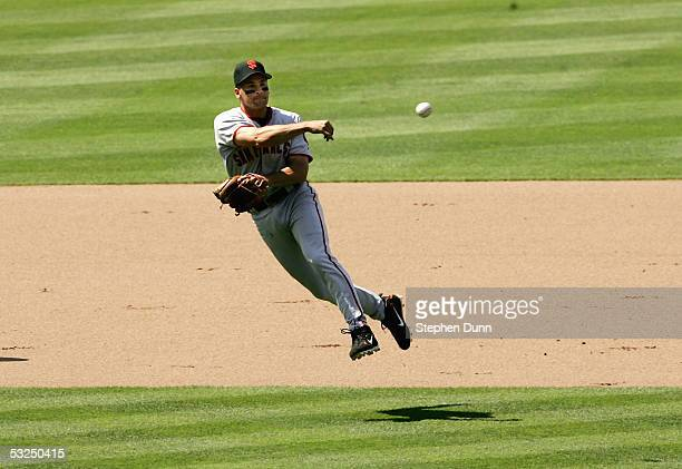 Shortstop Omar Vizquel of the San Francisco Giants throws to first get Jeff Kent of the Los Angeles Dodgers h two out and two on in the seventh...