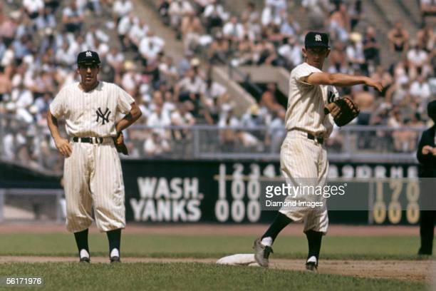 Shortstop Phil Rizzuto and secondbaseman Billy Martin of the New York Yankees during warm ups prior to the start of the fourth inning of a game...
