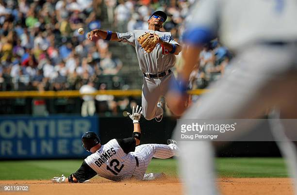 Shortstop Rafael Furcal of the Los Angeles Dodgers gets a force out on Clint Barmes of the Colorado Rockies but is unable to complete the double play...