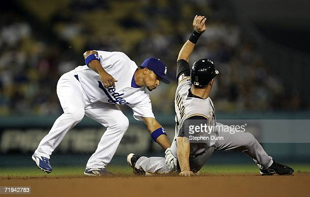 Shortstop Rafael Furcal of the Los Angeles Dodgers tags out Jack Wilson of the Pittsburgh Pirates who was picked off while attempting to steal on...