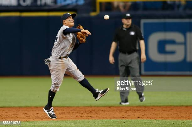 Shortstop Ronald Torreyes of the New York Yankees fields the ground out by Kevin Kiermaier of the Tampa Bay Rays to end the sixth inning of a game on...