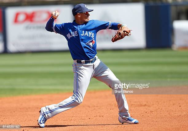 Shortstop Ryan Goins of the Toronto Blue Jays makes the throw to first base for the out on Brandon Guyer of the Tampa Bay Rays during the first...