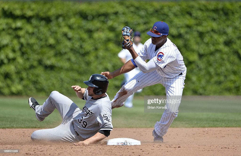 Shortstop Starlin Castro #13 of the Chicago Cubs (R) forces out Casper Wells #39 of the Chicago White Sox at second base on a ground ball hit by Alexei Ramirez #10 of the Chicago White Sox during the fifth inning at Wrigley Field on May 29, 2013 in Chicago, Illinois.