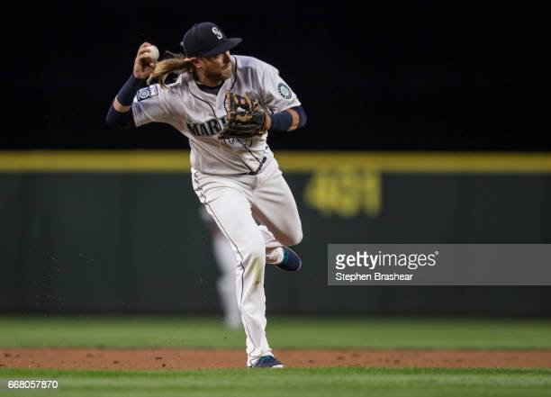 Shortstop Taylor Motter of the Seattle Mariners throws to first after fielding a ground ball during game against the Houston Astros at Safeco Field...