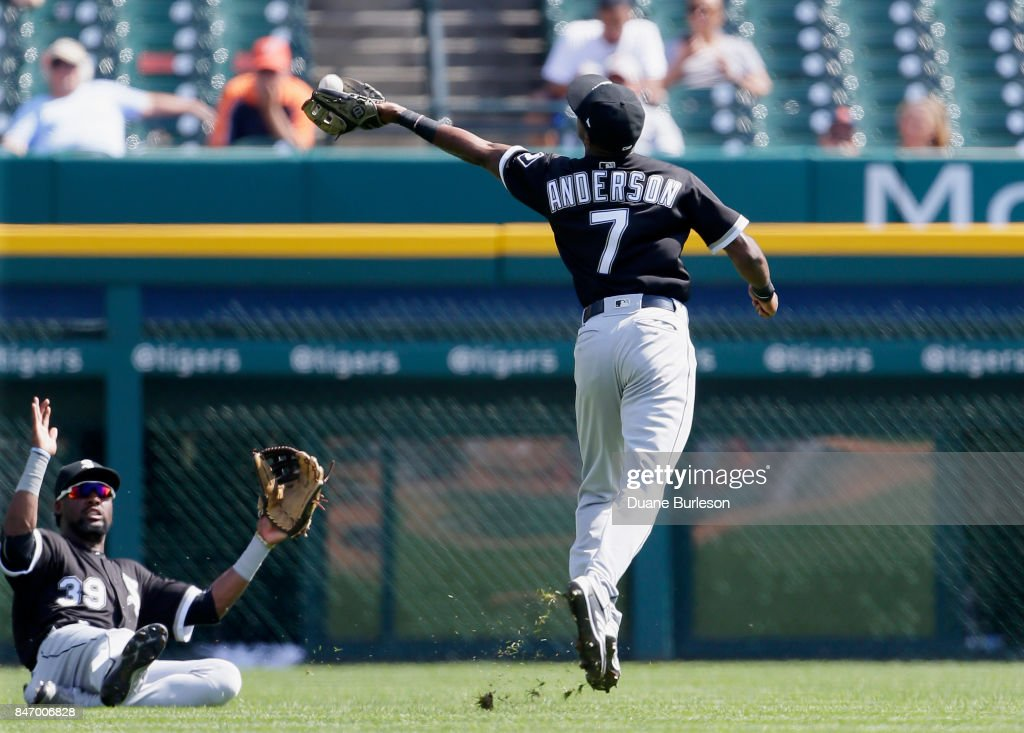 Shortstop Tim Anderson #7 of the Chicago White Sox catches a fly ball hit by Jeimer Candelario of the Detroit Tigers as left fielder Alen Hanson #39 of the Chicago White Sox slides to avoid the play during the first inning at Comerica Park on September 14, 2017 in Detroit, Michigan.