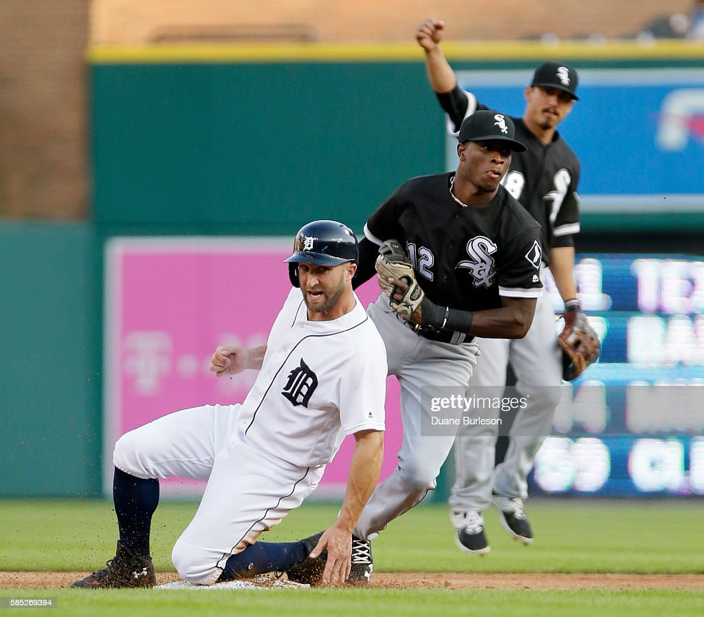 Shortstop Tim Anderson #12 of the Chicago White Sox heads for the dugout after tagging out Tyler Collins #18 of the Detroit Tigers trying to steal second base as Tyler Saladino #18 of the Chicago White Sox celebrates during the second inning at Comerica Park on August 2, 2016 in Detroit, Michigan.