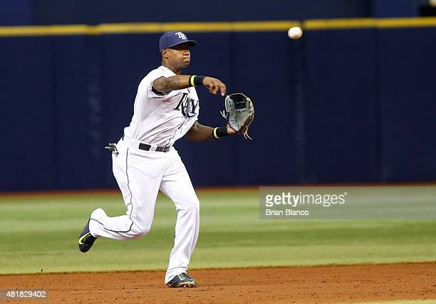 Shortstop Tim Beckham of the Tampa Bay Rays throws out Chris Parmelee of the Baltimore Orioles at first base during the third inning of a game on...