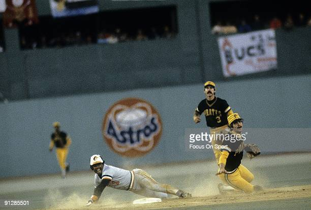 Shortstop Tim Foli of the Pittsburgh Pirates gets his throw off to first avoiding the slide of Baltimore Orioles Al Bumbry during a 1979 world series...