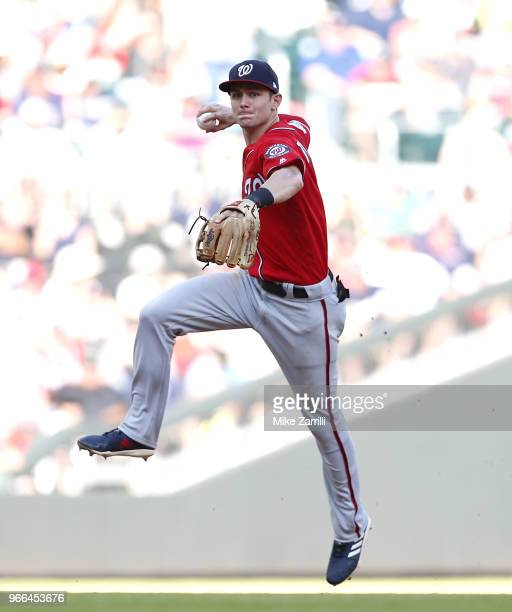Shortstop Trea Turner of the Washington Nationals makes a throw in the eighth inning during the game against the Atlanta Braves at SunTrust Park on...