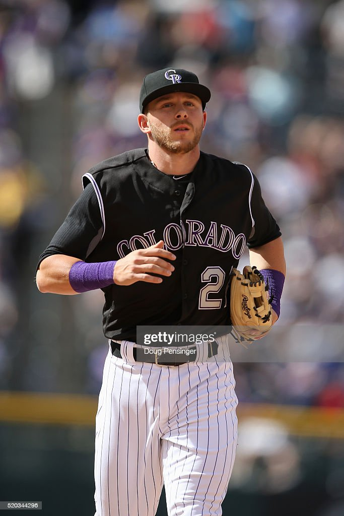 Shortstop Trevor Story #27 of the Colorado Rockies heads to the dugout against the San Diego Padres on April 10, 2016 in Denver, Colorado. The Rockies defeated the Padres 6-3.