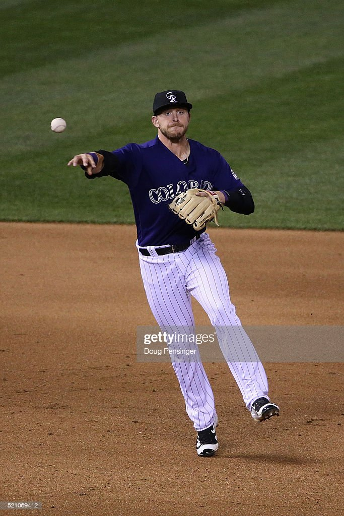 Shortstop Trevor Story #27 of the Colorado Rockies throws out a runner against the San Francisco Giants at Coors Field on April 13, 2016 in Denver, Colorado. The Rockies defeated the Giants 10-6.