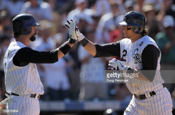 Shortstop Troy Tulowitski of the Colorado Rockies is welcomed home by Todd Helton after his solo home run off of relief pitcher Bill Bray of the...