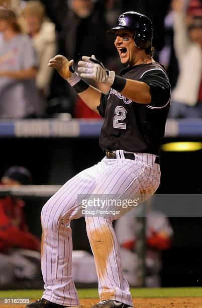 Shortstop Troy Tulowitzki of the Colorado Rockies celibrates after scoring the gamewinning run against the St Louis Cardinals on a sacrifice fly by...