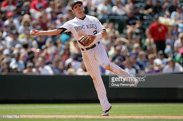 Shortstop Troy Tulowitzki of the Colorado Rockies fields a gound ball and throws out the runner against the Detroit Tigers at Coors Field on June 19...