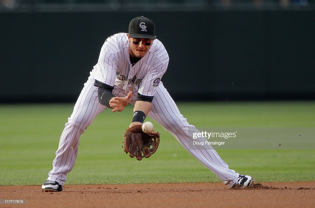 Shortstop Troy Tulowitzki #2 of the Colorado Rockies fields a ground ball against the Chicago White Sox during Interleague play at Coors Field on June 29, 2011 in Denver, Colorado. The White Sox defeated the Rockies 3-2.