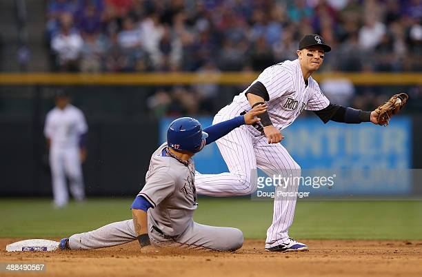 Shortstop Troy Tulowitzki of the Colorado Rockies gets a force out on ShinSoo Choo of the Texas Rangers at second base in the third inning during...