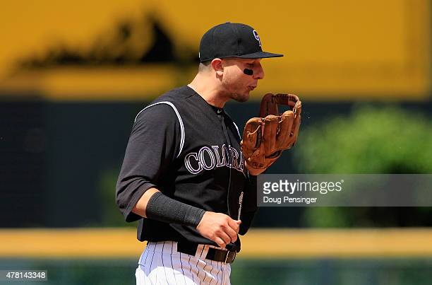 Shortstop Troy Tulowitzki of the Colorado Rockies prepares his glove plays defense against the Miami Marlins at Coors Field on June 7 2015 in Denver...