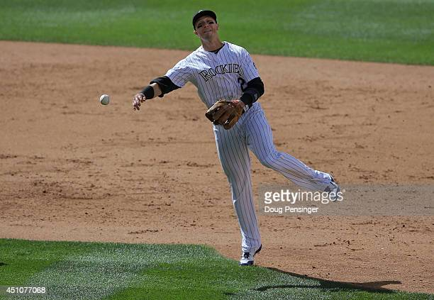 Shortstop Troy Tulowitzki of the Colorado Rockies throws out a runner against the Milwaukee Brewers at Coors Field on June 22 2014 in Denver Colorado...
