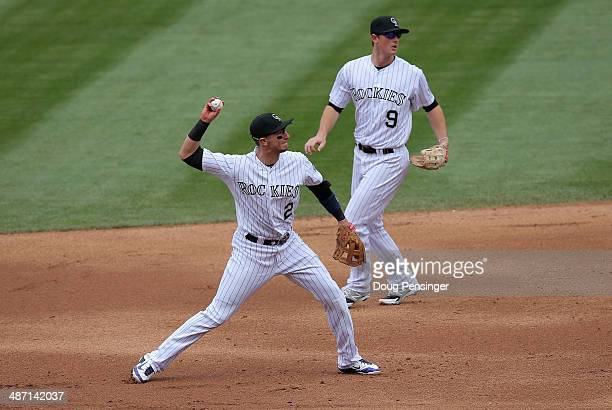 Shortstop Troy Tulowitzki of the Colorado Rockies throws out a runner against the San Francisco Giants as second baseman DJ LeMahieu of the Colorado...
