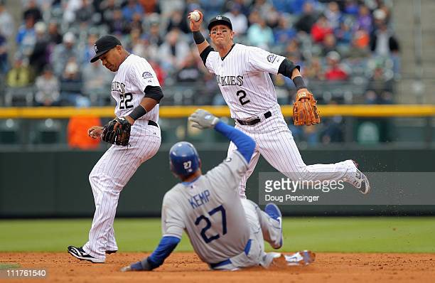 Shortstop Troy Tulowitzki of the Colorado Rockies turns a double play over Matt Kemp of the Los Angeles Dodgers after he fielded a ground ball by...