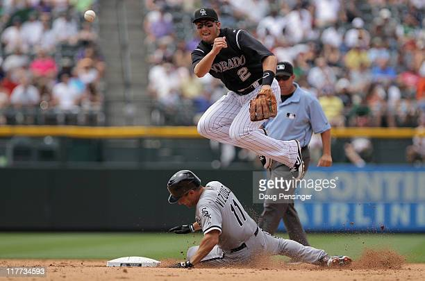 Shortstop Troy Tulowitzki of the Colorado Rockies turns a double play as he gets the force on Omar Vizquel of the Chicago White Sox at second on a...