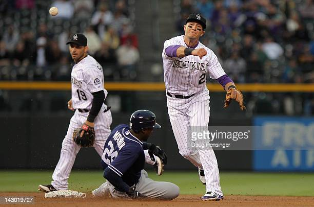 Shortstop Troy Tulowitzki of the Colorado Rockies turns a double play on Cameron Maybin of the San Diego Padres on a ball hit by Mark Kotsay of the...