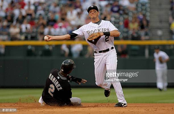 Shortstop Troy Tulowitzki of the Colorado Rockies turns a double play over Hanley Ramirez of the Florida Marlins in the fifth inning at Coors Field...