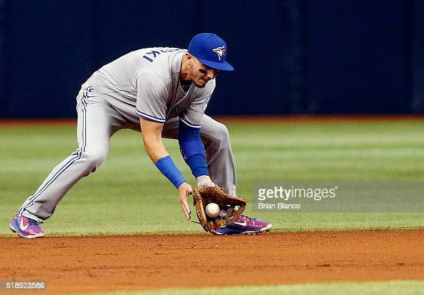 Shortstop Troy Tulowitzki of the Toronto Blue Jays fields the ground out by Logan Morrison of the Tampa Bay Rays during the first inning of a game on...