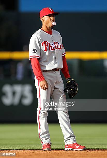Shortstop Wilson Valdez of the Philadelphia Phillies blows bubble gum as he looks on as he plays defense against the Colorado Rockies at Coors Field...