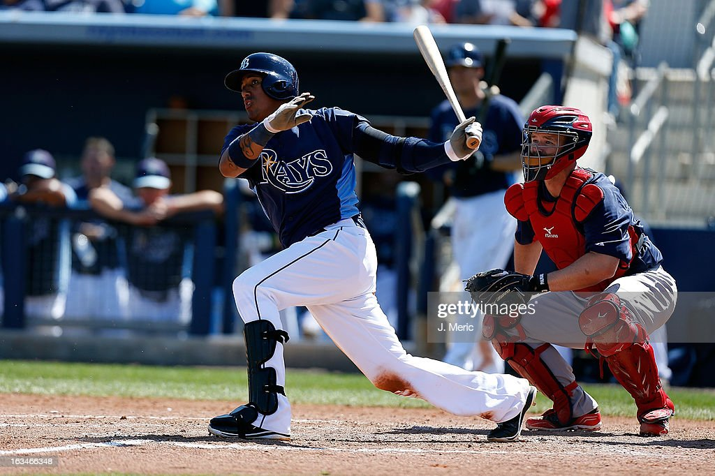 Shortstop Yunel Escobar #11 of the Tampa Bay Rays fouls off a pitch as catcher David Ross #3 of the Boston Red Sox looks on during a Grapefruit League Spring Training Game at the Charlotte Sports Complex on March 10, 2013 in Port Charlotte, Florida.