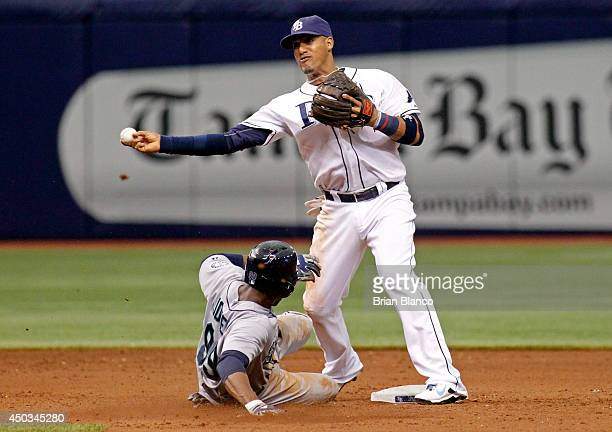 Shortstop Yunel Escobar of the Tampa Bay Rays gets the out at second base on James Jones of the Seattle Mariners off of the fielder's choice by...