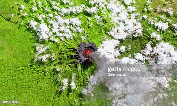JAVA INDONESIA JULY 11 A ShortwaveInfrared satellite view of Raung Volcano and the surround vegetation in green on July 11 2015 in Java Indonesia...