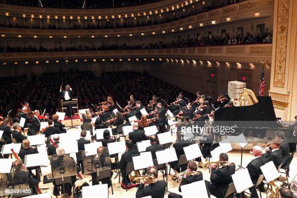 Shostakovich for the Children of Syria Orchestra performing at Carnegie Hall on Monday night January 13 2013This imageGeorge Mathew leading the...