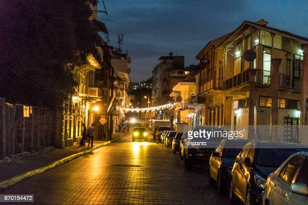 Shot at dusk, Casco Viejo also called Casco Antiguo, Panama City's Old Quarter established in 1673, with its old buildings, cars and unrecognizable persons in background.