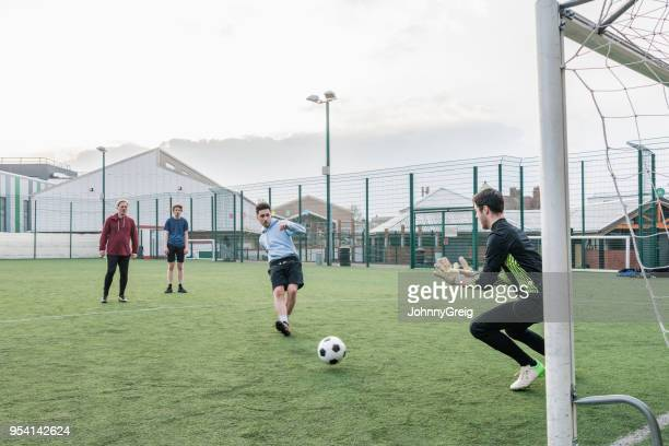 shot at goal on football pitch - amateur stock pictures, royalty-free photos & images