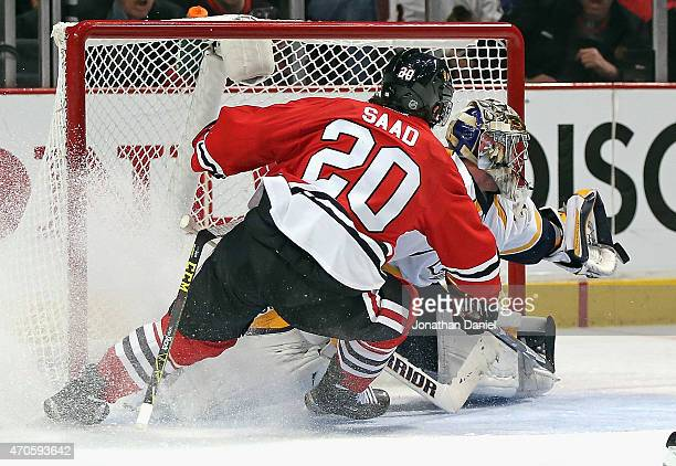 A shot by Brandon Saad of the Chicago Blackhawks goes off the glove of Pekka Rinne of the Nashville Predators in Game Four of the Western Conference...