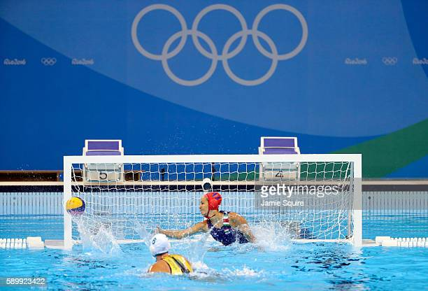 A shot by Bronwen Knox of Australia against goalkeeper Orsolya Kaso of Hungary hits the post during a shootout in their Women's Water Polo...