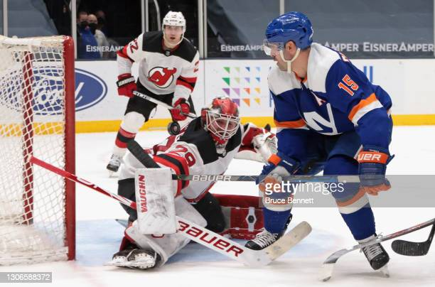 Shot by Cal Clutterbuck of the New York Islanders rolls off the shoulder of Mackenzie Blackwood of the New Jersey Devils during the second period at...
