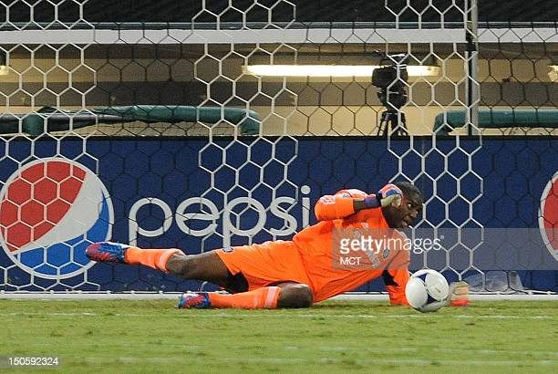 Shot by D.C. United midfielder Dwayne De Rosario , not pictured, beats, Chicago Fire goalkeeper Sean Johnson for a goal in the first half at RFK...