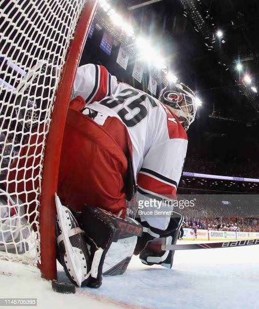 A shot by Devon Toews of the New York Islanders in the last minute of the second period gets past Curtis McElhinney of the Carolina Hurricanes but...