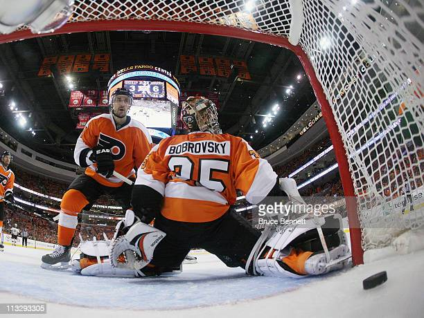 A shot by Gregory Campbell of the Boston Bruins eludes Sergei Bobrovsky of the Philadelphia Flyers late in the third period in Game One of the...