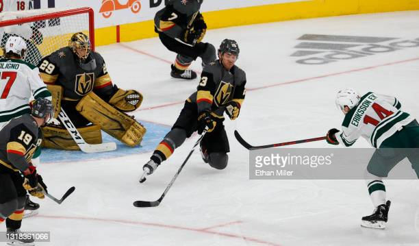 Shot by Joel Eriksson Ek of the Minnesota Wild deflects off of the right skate of Alec Martinez and gets past Marc-Andre Fleury of the Vegas Golden...