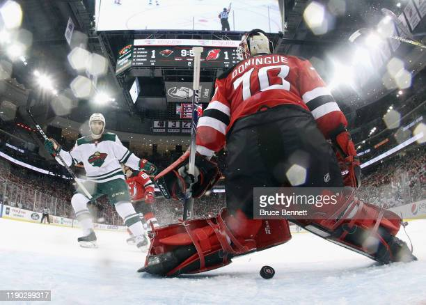 A shot by Jordan Greenway of the Minnesota Wild eludes Louis Domingue of the New Jersey Devils at 1007 of the second period at the Prudential Center...