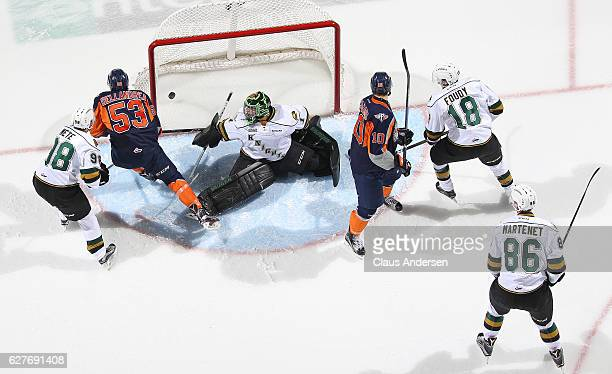 A shot by Kole Sherwood of the Flint Firebirds beats Tyler Parson of the London Knights during an OHL game at Budweiser Gardens on December 4 2016 in...