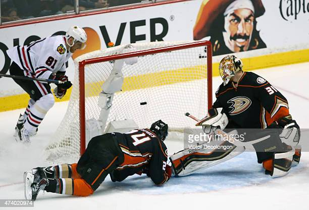 A shot by Marian Hossa of the Chicago Blackhawks gets past goaltender Frederik Andersen of the Anaheim Ducks in the first period of Game Two of the...
