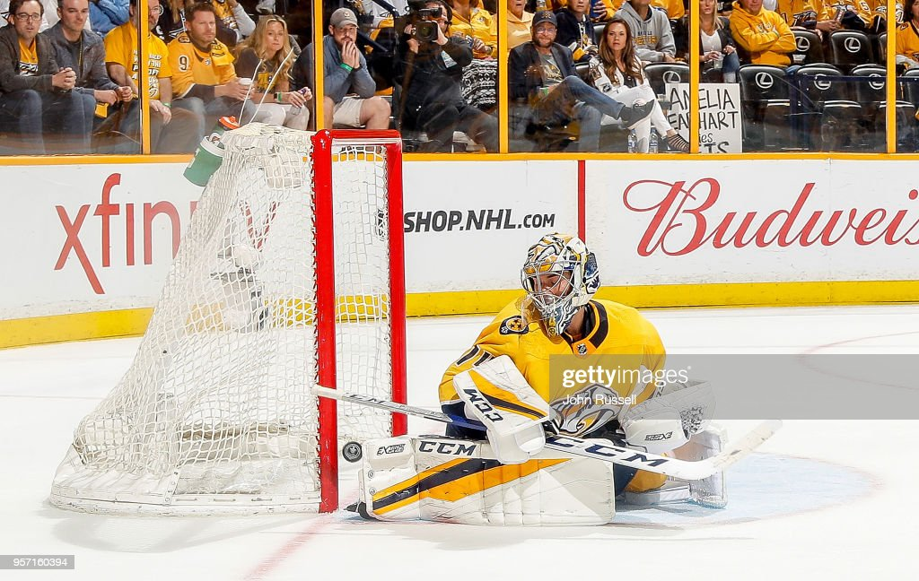 A shot by Mark Scheifele #55 of the Winnipeg Jets finds the net for a goal against Juuse Saros #74 of the Nashville Predators in Game Seven of the Western Conference Second Round during the 2018 NHL Stanley Cup Playoffs at Bridgestone Arena on May 10, 2018 in Nashville, Tennessee.